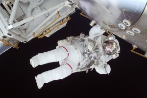 Astronaut fixing space ship.