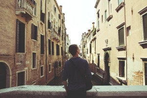 A man on a bridge in Venice, Italy